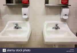 public bathroom sink. Public Bathroom In A Shopping Mall,lavatories, Soap Dispenser And Mirrors.  Oklahoma City Public Sink H