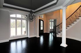 formal dining rooms with columns. the formal dining room, open to foyer, curved staircase, and two story great features black, gray, white features. rooms with columns