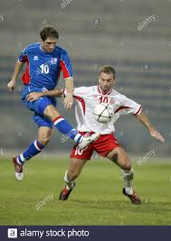 Iceland's Thordor Gudjonsson and Malta's Ivan Woods fight for the ball  during World Cup qualifier at Ta' Qali National Stadium outside Valletta.  Iceland's Thordur Gudjonsson (L) and Malta's Ivan Woods (R) fight
