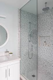 gray and blue mosaic shower tiles with shower niche