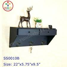 black shelf with hooks