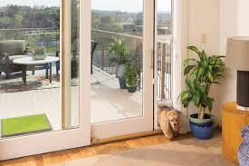 image of sliding glass door with dog door built in