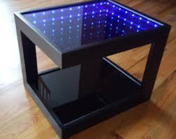 infinity mirror table. black coffee table with cool illusion lights, featuring infinity mirror effect