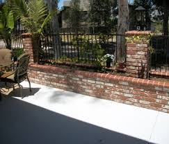 Brick and wrought iron fence Front yard landscaping Ideas