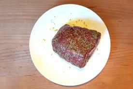 seasoned beef roast on a white plate