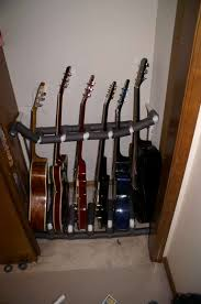 i have it wedged between a wall and a wooden bookshelf which makes it very sy i added some more protection between the guitars as well as a locking