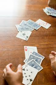 Each player turns up a card at the same time and the player with the higher card takes both cards and puts them, face down, on the bottom of his stack. War And Variants Games For Young Minds