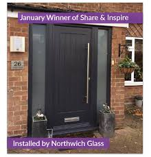 a rockdoor from our ultimate range the indiana in yep you guessed it anthracite grey installed by northwich glass with two misted glass side panels