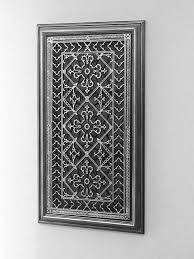 the door assembly is framed with wood moulding in the same finish as the decorative grille