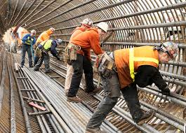 steel workers forming a rebar cage by wsdot rebar worker