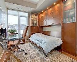 home office bedroom. contemporary freestanding desk medium tone wood floor home office idea in ottawa with beige walls bedroom f
