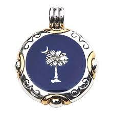 shiny round two tone palmetto moon slide with dark blue background south carolina jewelry