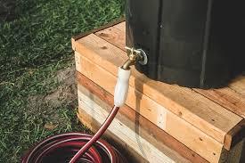 how to make an inexpensive diy rain barrel