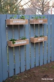 How to paint a fence and make stenciled cedar planters for a DIY hanging  fence garden