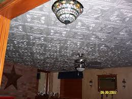 remove the cost of asbestos ceilings by gluing styrofoam ceiling tiles over existing surface