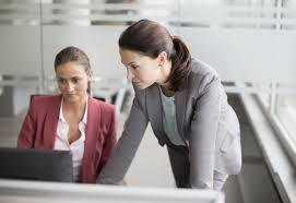 sample human resources assistant job description two women work on learning the new human resources management information system hris