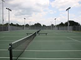 How Much Does It Cost To Light A Tennis Court Tennis Courts Court Builders Tennis Court Construction