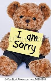 teddy bear holding yellow sign that says i am sorry csp50291984