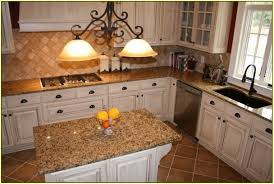 tropic brown granite with white cabinets