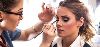 how to apply camera friendly makeup for men and women woman applying makeup