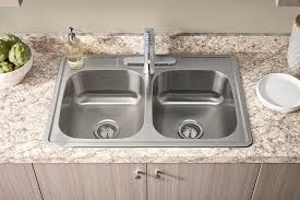 new kitchen sink installation. featuring 20-gauge stainless steel construction for lasting beauty, the new colony collection of kitchen sink installation