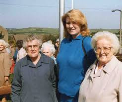 Over 60s Club 1988 waiting for coach for a day out in Matlock. Ida Bradley,  Joanna Heathcoat with her grandma Mrs Luck. Photo copyright of Lois Burton  (nee Warner) | Killamarsh Heritage Society