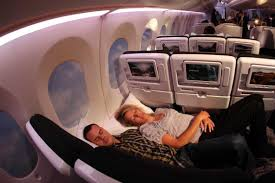 two people can lie on the flat seats in economy on air new zealand flights flickr kent wein