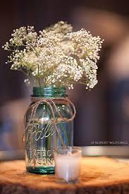 Mason Jars Decorated With Twine Mason jar twine baby's breath and tree stump as centerpiece 3