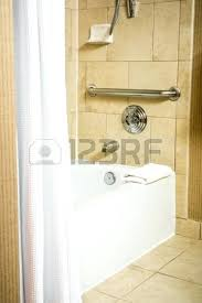 handicap accessible bathtub handicapped accessible bathtub in a hotel room with grab bar stock photo picture handicap accessible bathtub
