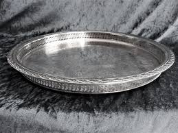 large round silver plated serving tray with beautiful engravings and raised gallery edge w m rogers son usa
