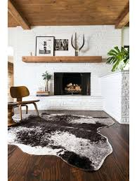 brown cow print rug rugs grand canyon faux hide rug grand canyon rug power loomed of acrylic felt backing features an animal print pile material wool cotton