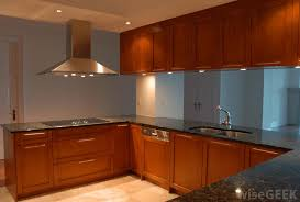 puck lights are small round lights installed underneath cabinets that focus light on the countertop below