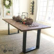 a wooden and metal modern diy dining room table