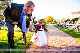 flower girl gets help spreading flowers at nj outdoor wedding ceremony