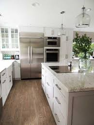 river white on shaker style cabinets with laminate floors that look like hardwood