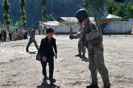 u s department of defense photo essay u s army spc joshua layton encourages a child to board a ch 47