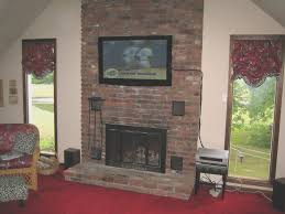 fireplace top hang tv above brick fireplace decor idea stunning classy simple and room design ideas