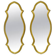 pair of vintage carved wood hollywood regency textured gold narrow wall mirrors for