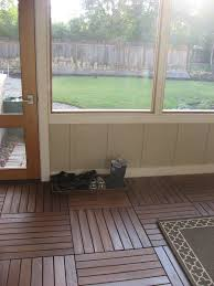 we ordered these wood floor tiles waaaay back in august but between the solar installers using the porch to their equipment and then plain old