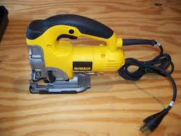dewalt power tools saw. a jig saw is pretty cool power tool, it gives the user lot of freedom to make variety cuts, not just straight lines. dewalt model tools s