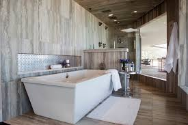 chic freestanding tubs in bathroom contemporary with daltile square white subway next to vertical tile alongside ceramic tile shower and pony wall