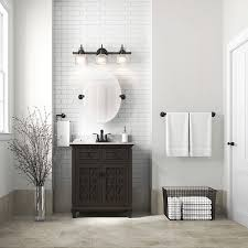 espresso vanity with a white countertop subway wall tile an oval frameless mirror and