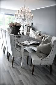 black and white dining table set: grey rustic dining table with beautiful fabric chairs the combination is modern and elegant