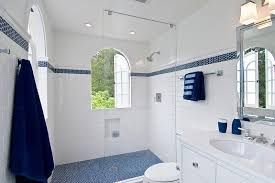 photo 6 of 8 view in gallery penny tile floor in the shower area and accent towels bring the blue