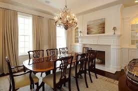 traditional dining room with built in bookshelf elk lighting circeo 12 light candle chandelier