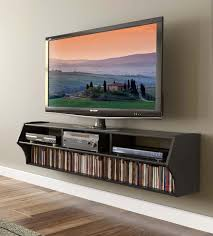 inspiring wall mounted TV cabinet with retro design also DVD player also  brown laminate floor also brown wall paint color also LED sharp TV also a  book ...