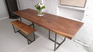 dining room long brown wooden table with black steel legs plus brown bench with black