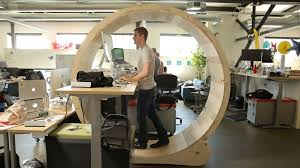 cubicle standing desk hamster wheel embrace the rodent race cnet 5