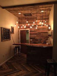 Love this bar area! Pallet base timber slab top, pallet wall and the  pendant lights!