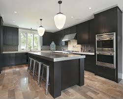 the espresso kitchen cabinets with black appliances